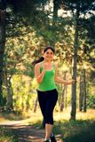 Young beautiful girl doing physical exercises in a park. royalty free stock photography