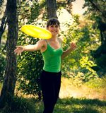 Young beautiful girl doing physical exercises in a park. royalty free stock photos