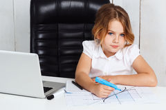 Young beautiful girl drawing graph at working place in office. Stock Image