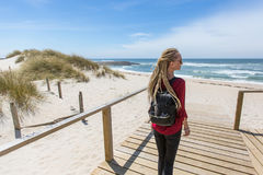 Young beautiful  girl with the dreads is on the path to the ocean. Stock Images