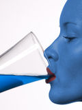 Young beautiful girl drinking a cocktail. Futuristic blue colour Stock Images
