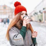 Young beautiful girl drinking hot coffee in the winter cold day Royalty Free Stock Images