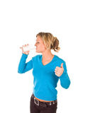 Young beautiful girl drinking milk Stock Photography