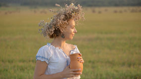 Young beautiful girl is drinking milk from a jug on the nature Stock Image