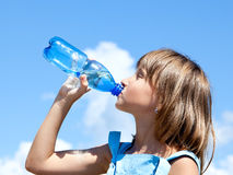 Young beautiful girl drinking water Stock Photos