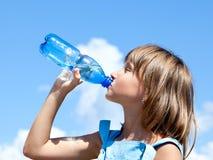 Young beautiful girl drinking water stock photos