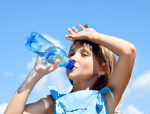 Young beautiful girl drinking water stock photography