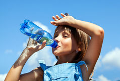 Young beautiful girl drinking water royalty free stock image