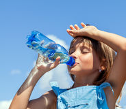 Young beautiful girl drinking water royalty free stock images