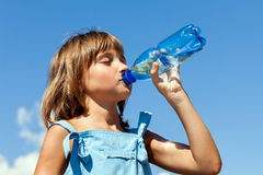 Young beautiful girl drinking water Royalty Free Stock Photo