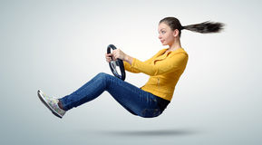 Young beautiful girl driver car with a wheel Stock Image