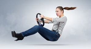Young beautiful girl driver car with a wheel Stock Photo