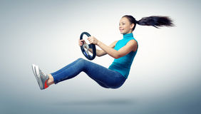 Young beautiful girl driver with a wheel Stock Photos