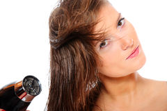 Young beautiful girl drying hair Royalty Free Stock Images