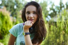 Young beautiful girl with earphones smiling. Royalty Free Stock Photography