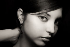 Young beautiful girl with earrings Stock Photography