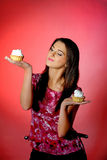 Young Beautiful Girl Eating  Small Sweet Cake