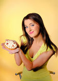 Young beautiful girl eating  small sweet cake Royalty Free Stock Image