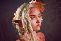 Young beautiful girl elf. Creative make-up and bodyart royalty free stock image