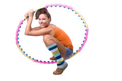 The young beautiful girl engaged in fitness. On a white background Royalty Free Stock Photo