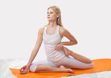 Young beautiful girl is  engaged in yoga Stock Photo