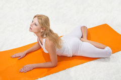 Young beautiful girl is  engaged in yoga Stock Photography