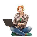 Young beautiful girl enjoying listening to music on headphones I Stock Photography