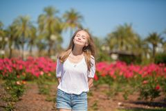 Young beautiful girl enjoying sunny day in Cannes Royalty Free Stock Images