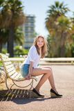 Young beautiful girl enjoying sunny day in Cannes Stock Images