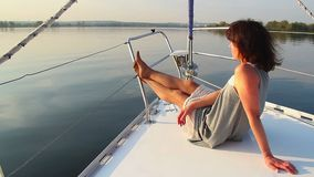 Young beautiful girl enjoying vacation on luxury yacht, tourism. Stock footage stock video footage
