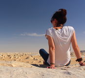 Young beautiful girl enjoys the views in the middle of the amazing White Desert Royalty Free Stock Photo
