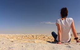 Young beautiful girl enjoys the views in the middle of the amazing White Desert Stock Photos