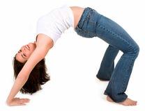 Young Beautiful Girl Exercising in Bridge Pose. A young beautiful brunette is in bridge pose Royalty Free Stock Photography