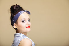 Young beautiful girl fancy make-up and hair bun Royalty Free Stock Photo