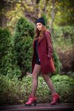 Young beautiful girl fashion shot / Autumn scene Stock Photography