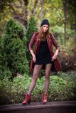 Young beautiful girl fashion shot / Autumn scene Royalty Free Stock Photography