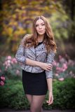 Young beautiful girl fashion shot / Autumn scene Royalty Free Stock Photo