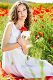 Young beautiful girl in the field of poppies Royalty Free Stock Photography