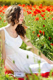 Young beautiful girl in the field of poppies Royalty Free Stock Photos