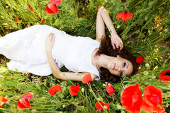 Young beautiful girl in the field of poppies Royalty Free Stock Photo