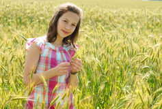 Young beautiful girl in a field of wheat Stock Photo
