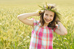 Young beautiful girl in a field of wheat Royalty Free Stock Photos