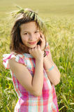 Young beautiful girl in a field of wheat Stock Photography