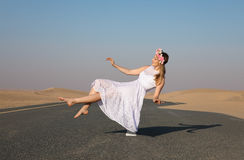 Young beautiful girl floating in the air. royalty free stock photo