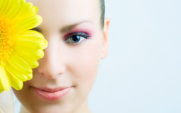 Young beautiful girl with flower. Stock Photo
