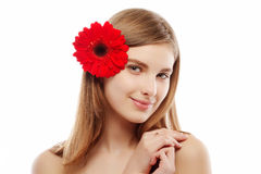 Young beautiful girl with a flower in hair Royalty Free Stock Photo