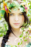 Young beautiful girl among the flowering trees Stock Photos