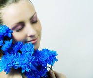 Young beautiful girl with flowers. Stock Images