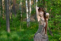 Young beautiful girl in the forest Stock Photos