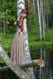 Young beautiful girl in the forest Royalty Free Stock Image
